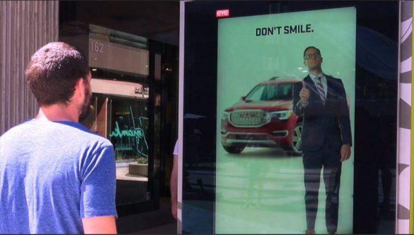 image of dooh advertising board interacting with man using AI facial analytics